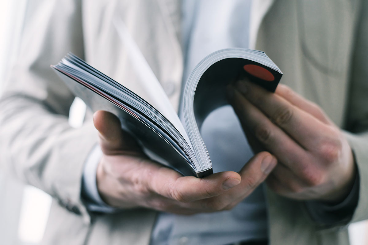 A man flipping through a book