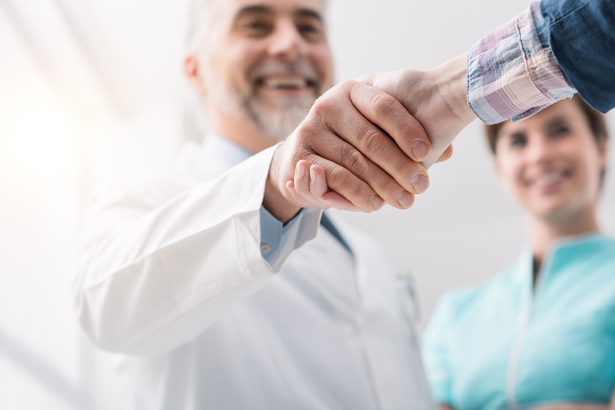 A doctor shaking hands