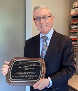 Mark Sperling holding Van Wyk Plaque